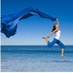 image of energetic woman on the beach