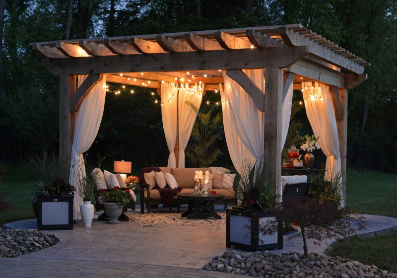 outdoor setting at night with a gazebo and fairy lights
