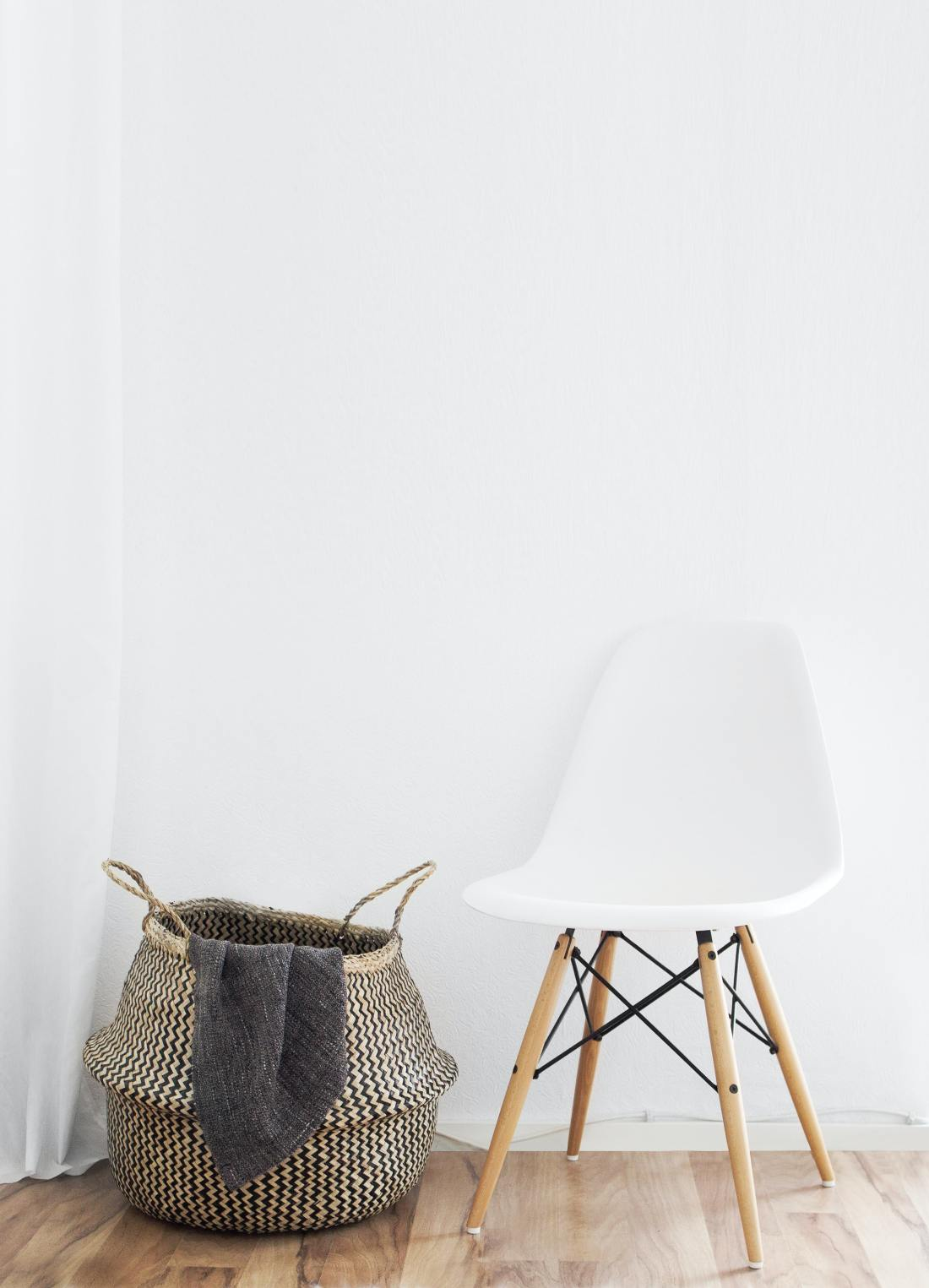 white chair and straw basket