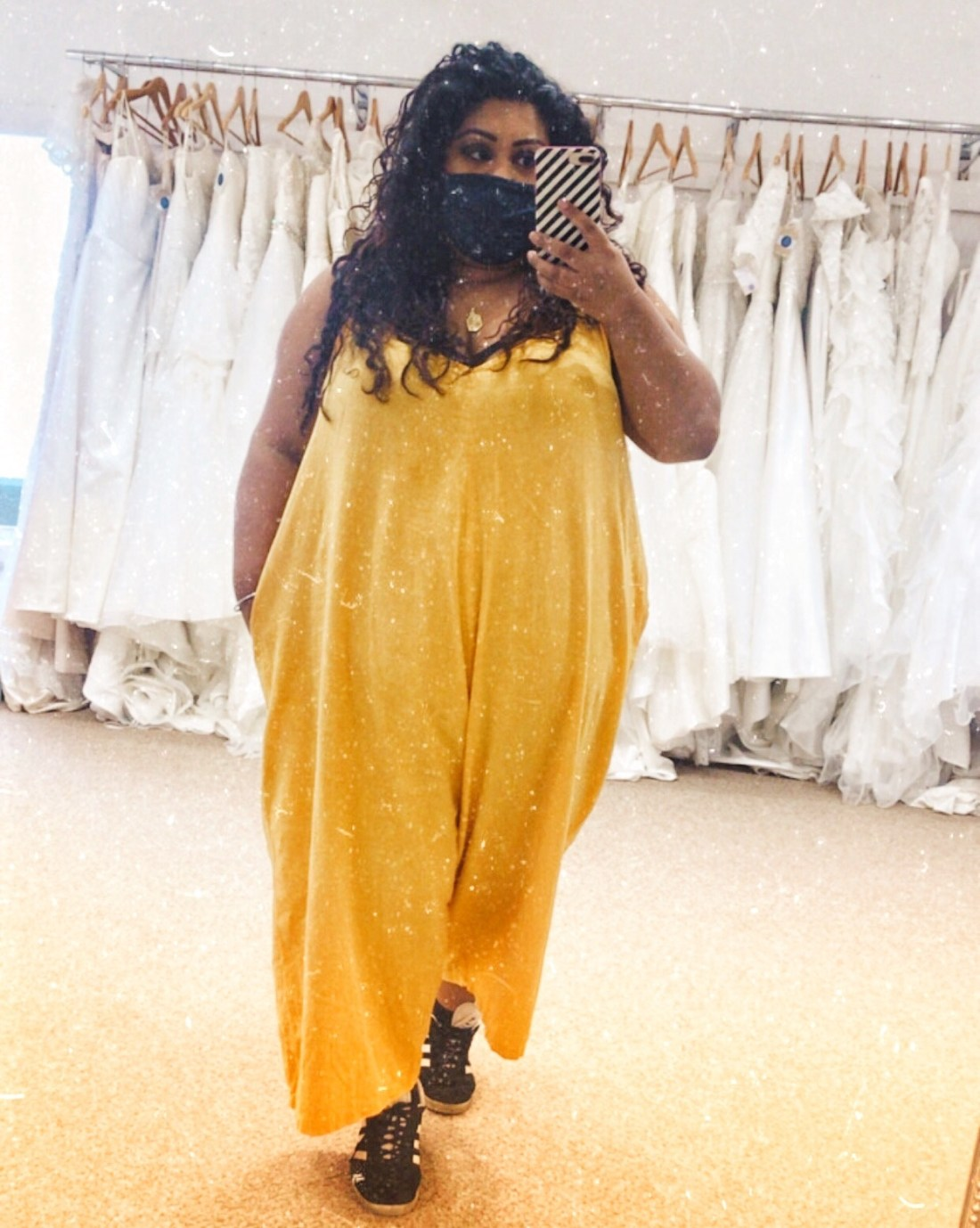 plus size girl in bright yellow mustard jumpsuit