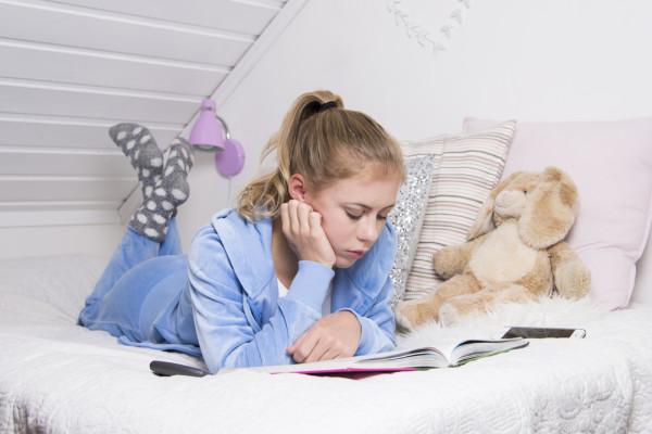 Girl Reading In Dorm