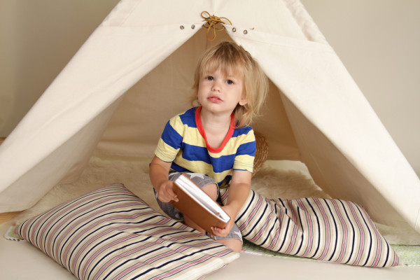 Child Reading in Teepee