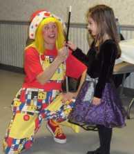 Clown entertaining a child