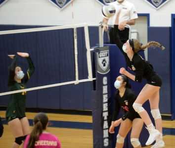 GCIT's Alexis Caltabiano (16) spikes the ball during a girls volleyball match against OLMA, Saturday, April 10, 2021.