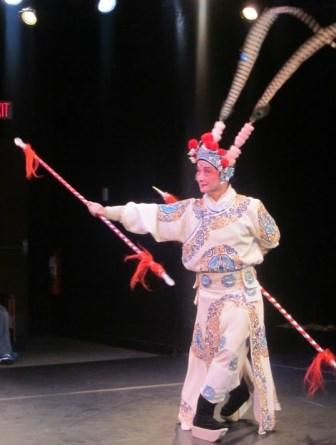 """Yao Zhong Zhang of the Nai-Ni Chen Dance Company in """"Double Spear Warrior."""""""