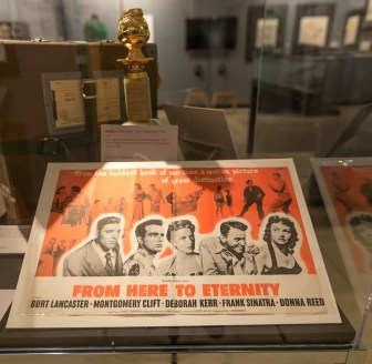 "A poster for ""From Here to Eternity"" and the Golden Globe Sinatra won for it are part of ""Sinatra: An American Icon."""