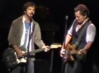 Eddie Vedder with Bruce Springsteen at the Continental Airlines Arena in 2004.