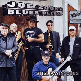 """The cover of Joe Zook and Blues Deluxe's 2004 album, """"Still Payin' Dues."""""""