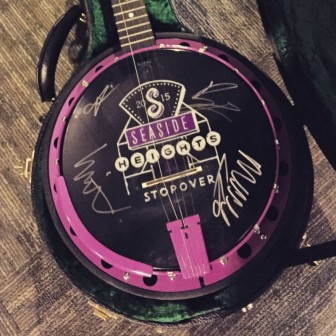 This banjo, signed by members of Mumford & Sons, will be auctioned for charity.