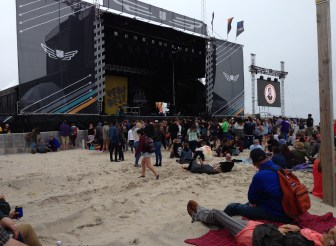 Festival-goers hang out on the beach, waiting for the music to begin, on Friday.
