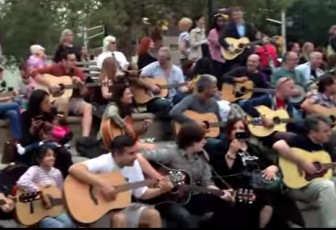 """Guitarists play """"Knockin' on Heaven's Door"""" together at Sinatra Park in Hoboken in 2013."""