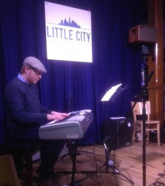 Andy Burton performs at Little City Books in Hoboken, Feb. 11.