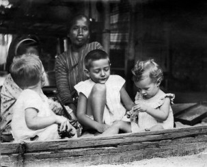 Anonymous photographer, East Indies (Indonesia), late 19th century. Local care taker with children of Dutch colonials.