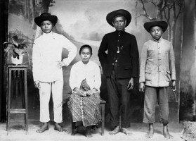 Anonymous studio photographer and posing family. East Indies (Indonesia) late 19th or early 20th century .