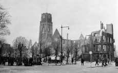 Anonymous photographer. Picture made after the bombardment of the city of Rotterdam by Nazi planes in May 1940. Between 600 and 900 people were killed and the centre of the city was left in ruins. 32 churches and synagogues were destroyed. Among them the Sint-Laurenskerk. The church was rebuild after the war. The modernist phone box in front of the church was a design from 1932 by Leendert van der Vlugt (1894-1936) of the Rotterdam studio Brinkman and Van der Vlugt, who also designed the world famous Van Nelle Factory in 1931. The Van Nelle Factory is now on the UNESCO world heritage list. Leendert van der Vlugt's phone box would be the standard phone box in the Netherlands for more than 50 years. It can still be seen in the Boijmans van Beuningen museum in the city. Today the whole city of Rotterdam is a proud icon of modern architecture.