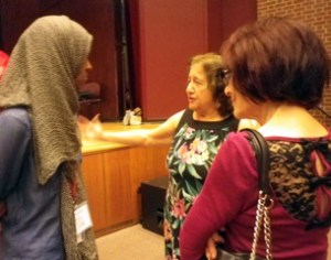 Joyce Fairchild talking with conference attendees.