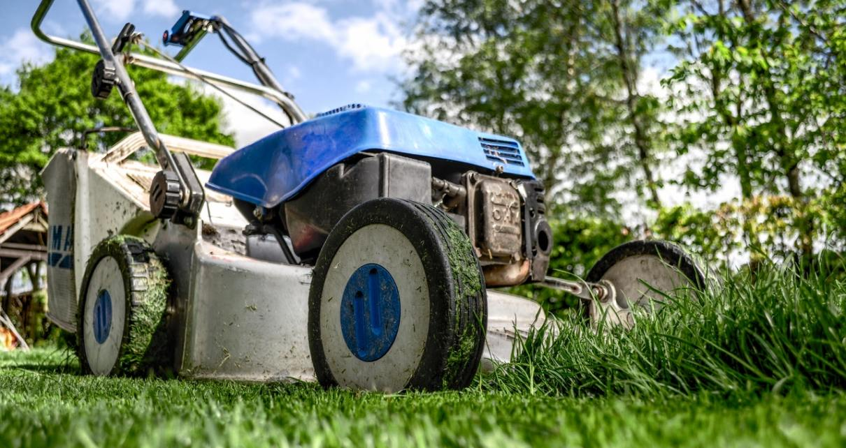 a blue lawn mower on the grass