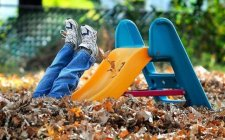 Photograph of a child having fun on a slide | NLP World.