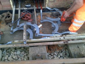 A close view of the holes being drilled to install lever 13's external crank. Note the bricked up lead out with draught exclusion measures behind the driller's arms