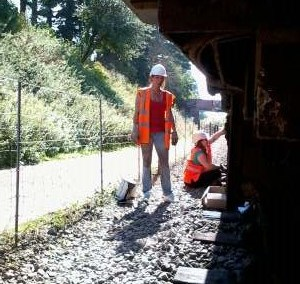 Nationwide Building Society Volunteers Helen and Vicky whilst cleaning the road dirt of Br Mk2 Coach 5174's B4 bogies, prior to painting. Photo: D.Millard