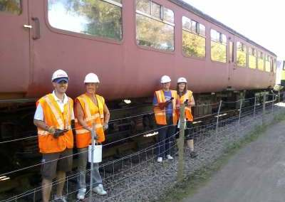 Nationwide Building Society volunteers, Rob, Helen, Vicky and Paul stand in front of BR Mk2 coach 5174 and its repainted B4 bogies. Photo: D.Millard