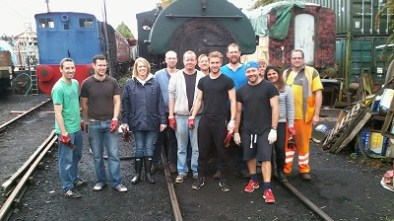 Nationwide Building Society volunteers stand in front of the Peckett steam locomotive, with Facilitator David Millard in orange Hi-Viz. Photo: G.Titmuss