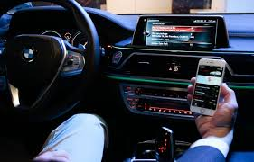 Photo of BMW iDrive screen and Connected app