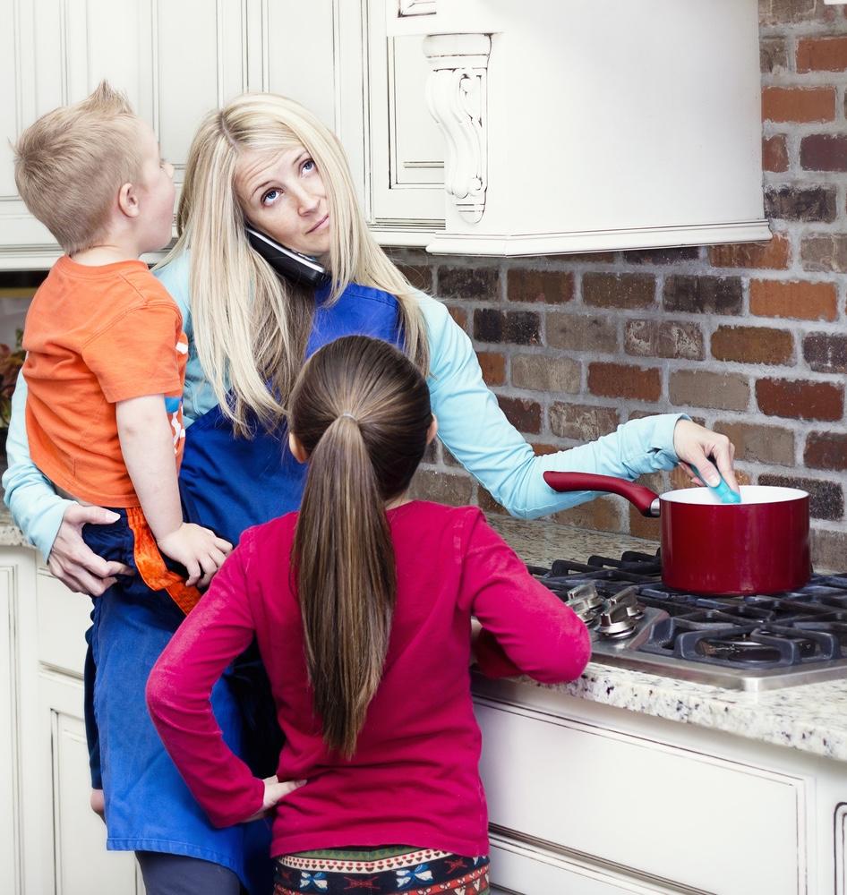 Overwhelmed mom in kitchen