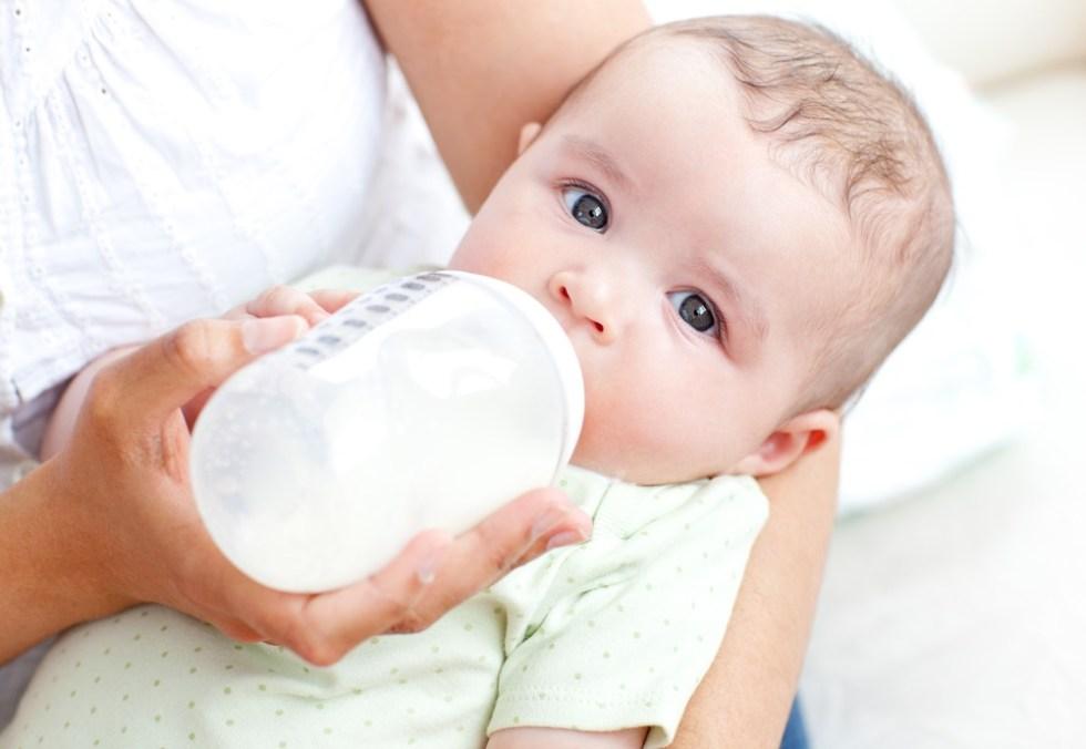 Mom bottle feeding son