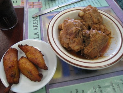 Fried plantains and Fricase de Puerco.