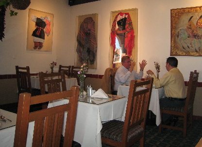 Regalia of Indian women and children are framed on the restaurant's walls.