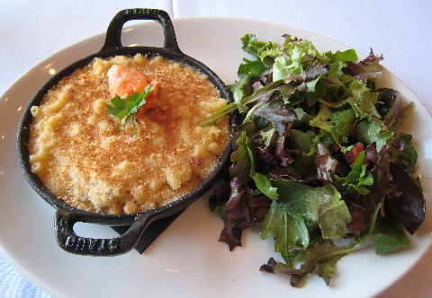 Lobster Mac-n-Cheese - a blend of lobster cream, cheese & Maine lobster pieces in a cast iron skillet
