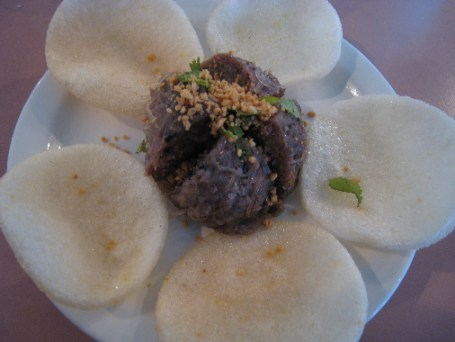 Lemon grass beef balls served with rice crackers.