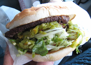 A gigantic double meat green chile cheeseburger