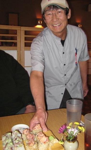 Mr. Noda delivers sushi to our table.