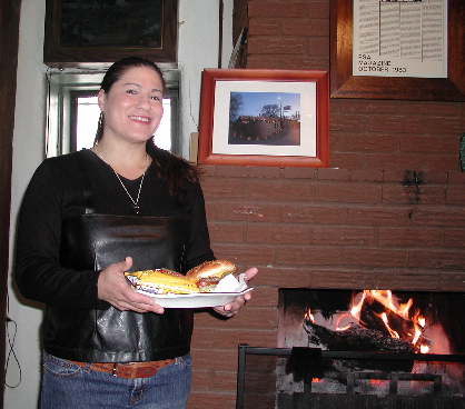 The lovely and talented Mayling Garcia bringing a green chile cheeseburger to our table. We've got the best seat in the house, by the fireplace.