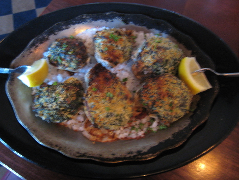 Oysters Rockefeller served on a bed of sea salt