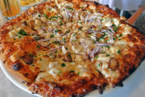 Barcelona Pizza: Marinara, chicken breast, mozzarella, cilantro, prosciutto & red onions