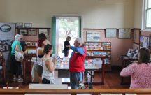 Volunteers John, Rod, & Linda helping visitors