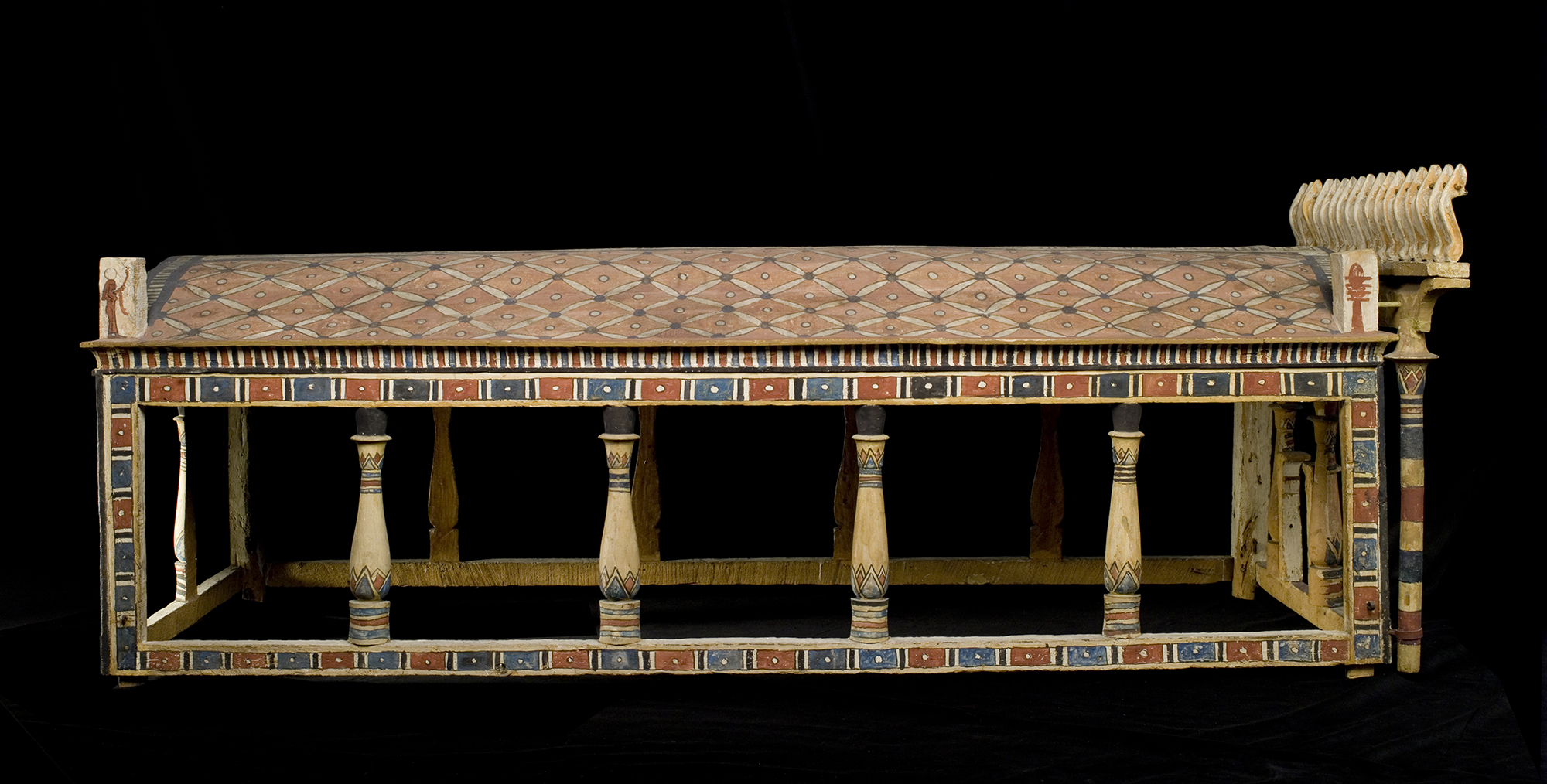 Canopy of sycamore-fig wood painted in red, black, blue, yellow and white in the shape of a shrine, with an arched roof and corner-posts : Ancient Egyptian, excavated by A.H. Rhind in the tomb of Montsuef at Sheikh Abd el-Qurna, Thebes, Early Roman period, c.9BC
