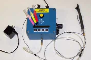 The Air Driven Elastomer Injection System includes the Control Box and the Handpiece.