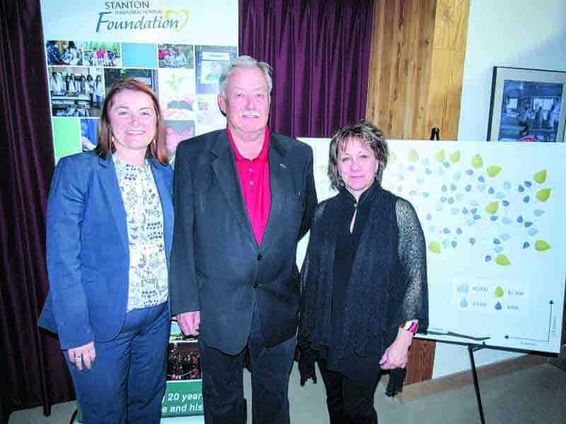 Sandra MacKenzie, chair of the Stanton Territorial Hospital Foundation, left stands in front of a mockup of the new donor tree, with foundation founding member Gordon Van Tighem and current executive director Linda Bussey on Thursday at the foundation's 20th anniversary celebration. The foundation received a $123,044.70 cheque from Bell Mobility Inc. -- leftover money from payment owed to Bell customers who were charged for a non-existent 911 service. - Jessica Davey-Quantick/NNSL file photo