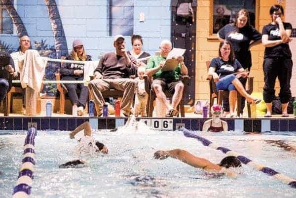 Coaches and parents keep count as swimmers complete as many lengths of the pool as they can during a fundraiser Wednesday, April 19. - Stewart Burnett/NNSL photo