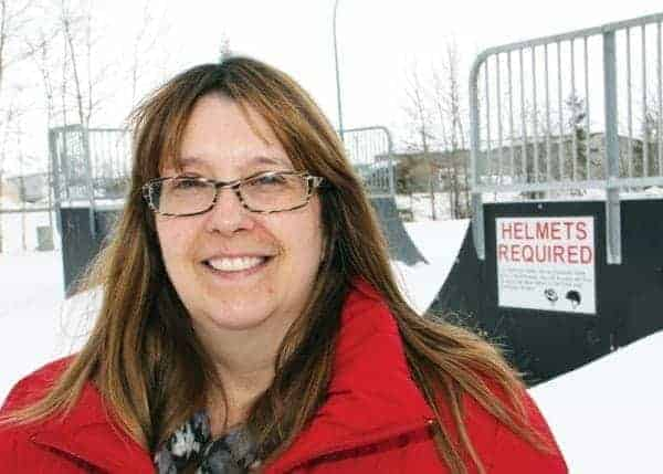 Louise Schumann, president of the Hay River BMX/Skate Park Association, stands in front of Chaser BMX/Skate Park. - NNSL file photo
