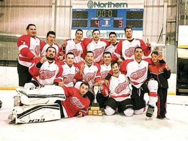 The 2017 Toonik Tyme senior men's champion Canadrill Red Wings of Rankin Inlet are, back row from left, Nick Dunphy, Roy Kopak, Roger Tagoona, Cody Dean, Keith (Butch) Sigurdson and David Clark. In the middle row, from left, are Andrew Simms, Chad Taipana, Pujjuut Kusugak, Rodney Taparti, Shack Merasty and Alaana Groves (stick boy). In the front from left, James Merritt and Panniuq Karetak in Iqaluit earlier this month. - photo courtesy of Lori Tagoona