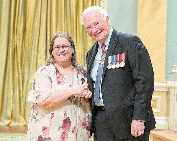 Gov. Gen. David Johnston presents Mary Fredlund of Rankin Inlet with the Sovereign's Award for Volunteer during a ceremony at Rideau Hall in Ottawa, Ont., on Monday, April 24. - photo courtesy of Mary Fredlund