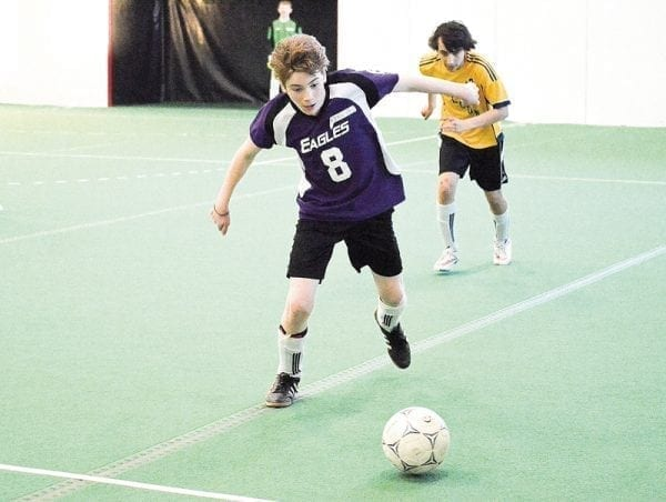 Sam Skinner races down the pitch with the ball during Super Soccer play last weekend in Yellowknife. - James McCarthy/NNSL photo