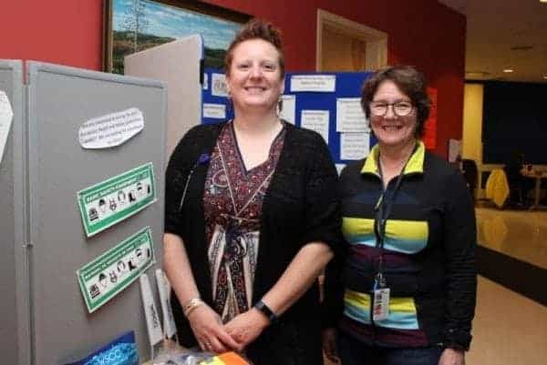 Natasha Kulikowski, left, and Michelle Lennie host an information booth about work safety at the Inuvik Regional Hospital Friday, May 12. The event was part of North American Occupational Safety and Health Week. Stewart Burnett/NNSL photo