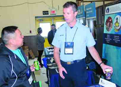 Cedric Autut, left, talks with Steve Thompson of the Canadian Coast Guard during the Kivalliq Trade Show in Rankin Inlet on Sept. 25, 2018. Darrell Greer/NNSL photo