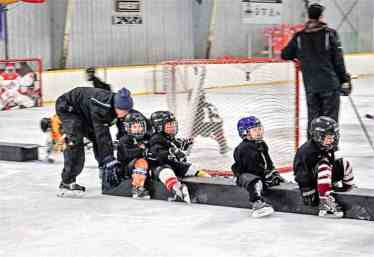 Youth leader Stephane (Piqut) Nukapiak pushes his group of initiation players forward along the ice during the annual Rankin Rock Season Opener hockey camp in Rankin Inlet on Oct. 14, 2018. Photo courtesy Rico Manitok